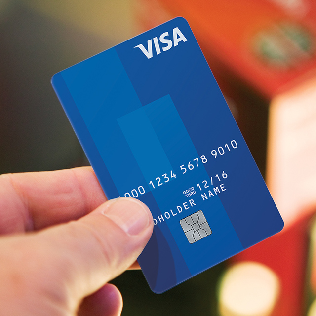Man holding Visa card.