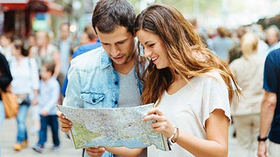 A young couple looking at a map